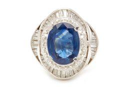 A PLATINUM, BLUE SAPPHIRE AND DIAMOND RING