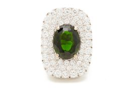 A GOLD, CHROME DIOPSIDE AND DIAMOND RING