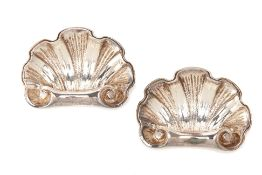 A PAIR OF CHRISTOFLE SILVER PLATED SHELL KNIFE RESTS