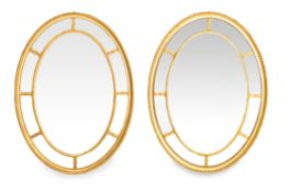 A PAIR OF ANTIQUE OVAL GILT MARGINAL MIRRORS