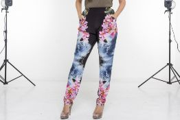 A PAIR OF STELLA MCCARTNEY FLORAL TROUSERS