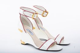A PAIR OF PRADA WHITE PATENT LEATHER WEDGE SANDALS EU 38