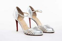 A PAIR OF CHRISTIAN LOUBOUTIN SILVER STRAPPY HEELS EU 38.5