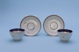 A PAIR OF SPIRALLY FLUTED TEA BOWLS AND SIMILAR SAUCERS