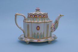 A POLYCHROME TEAPOT AND STAND