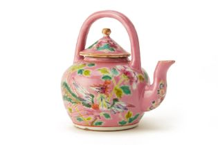 A PERANAKAN PINK-GROUND TEAPOT WITH AN ARCHED HANDLE