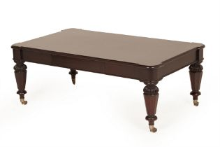 A STAINED WOOD COFFEE TABLE