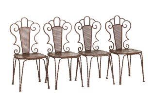 A SET OF FOUR WROUGHT IRON BISTRO CHAIRS