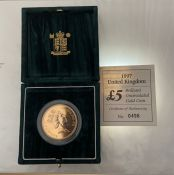 Boxed 1997 £5 Brilliant Uncirculated Gold Coin - numbered 0496 - 39.94 grams.