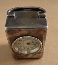 "Vintage Goldsmith Company Miniature Silver Cased Clock - 3"" x 2 1/8"" x 1 9/16""."