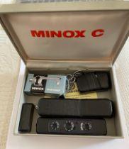 Vintage Boxed Black Minox C with accessories.