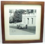 A framed signed photograph of Stirling Moss at Monte Carlo
