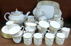 A Royal Doulton Lichfield tea and coffee service, with teapot, cream and sugar, cake plate and eight