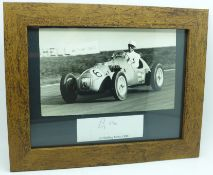 A mounted picture and signature of Stirling Moss in 1951, framed