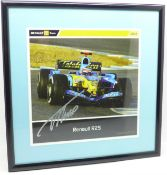 A framed and signed picture of double world champion Fernando Alonso