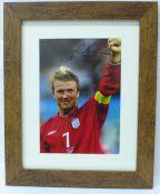 A framed signed photograph of David Beckham