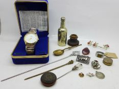 A novelty plated beer bottle shaped pepper, a wristwatch, an aluminium ring, an unmounted compass,