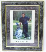 A framed signed picture of Nick Faldo