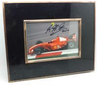 A signed picture of Michael Schumacher, framed
