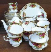 A Royal Albert Old Country Roses tea set and two cake plates, fourteen cups, nineteen saucers,