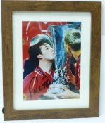 A framed signed photograph of Robbie Fowler with UEFA Cup