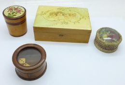 Three treen items including a dice shaker and a circular box depicting a religious scene in the