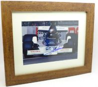 A framed and signed photograph of 1978 world champion Mario Andretti