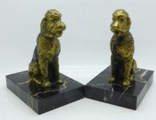 A pair of metal Art Deco dog bookends on marble bases, height 13.5cm