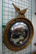 A Regency style gilt framed convex mirror, 66cms h