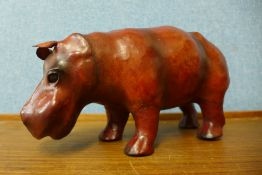 A small leather figure of a hippopotamus, 30cms l