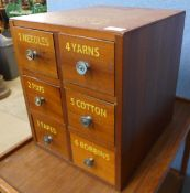 A beech six drawer counter top haberdashery cabinet, bearing Clark & Co, Anchor Mills inscription