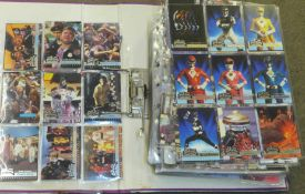 An album of collectors cards, including Justice League, Power Rangers, Marvel, 007, etc.