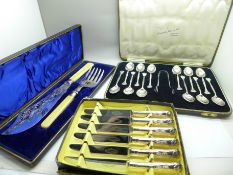 A cased set of twelve plated Arts and Crafts tea spoons, late Victorian fish servers and six cake