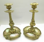 A pair of 19th Century French ormolu candlesticks, each set with three shells, 19.5cm