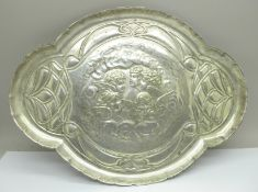 A plated dressing table tray with Reynolds angels, marked J.C. & Co. Ltd., 30cm