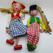 Two vintage Pelham puppets; Dutch girl and boy, with one box marked Dutch Boy