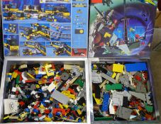A collection of Lego, in two Lego System boxes 6493 and 4559, (total weight 5.54kg)