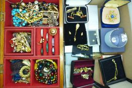 A wooden jewellery box and contents and a tray of costume jewellery, some boxed