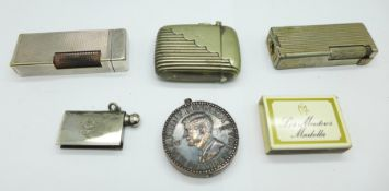 Three lighters including Dunhill, with initials, and novelty John F. Kennedy, a vesta case, etc.,