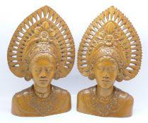 Two carved wooden busts, Djanger dancers, Bali, 24cm, one cracked