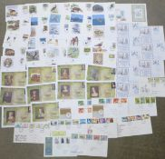 Fifty-four stamp first day covers;-twenty-five WWF, ten Henry VIII, eight Christmas and eleven