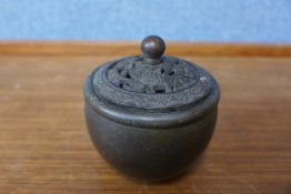 A small oriental bronze censor and cover, 8cms h