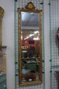 A rococo style gilt framed mirror, 135cms h