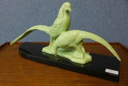 An Art Deco celadon coloured ceramic figure of two pheasants, 49cms l