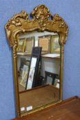 A rococo style gilt framed mirror, 69cms h