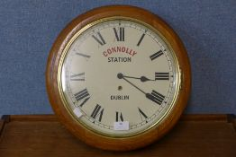An oak circular wall clock, bearing Connolly Station, Dublin inscription to dial, 39cms d