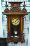 A 19th Century walnut Vienna wall clock, 80cms h