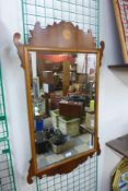 A George II style inlaid yew wood mirror, 98cms h