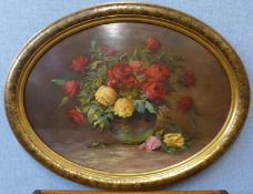 French School, oval still life of roses in a vase, oil on board, indistinctly signed, 53 x 74cms,