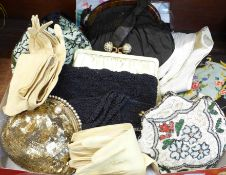 A collection of vintage purses, evening bags, two pairs of opera gloves, one other pair, a pair of